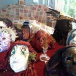 Devotional masks of Persephone, Crow, Baba Yaga, Star Goddess on red velvet cloth